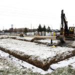 Snow covered soil showing new foundation for building