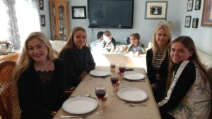 Danish students enjoy Thanksgiving dinner at their homestay with the Letourneau family on October 9.