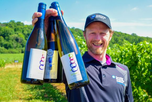 Winemaker Gavin Robertson is pictured at the Niagara College Teaching Winery with three wines that recently won medals at the All Canadian Wine Championships: 2015 Balance Semi-Dry Riesling (gold), 2015 Balance Viognier (bronze), and 2014 Marmitons Gastronomy Pinot Noir (bronze).