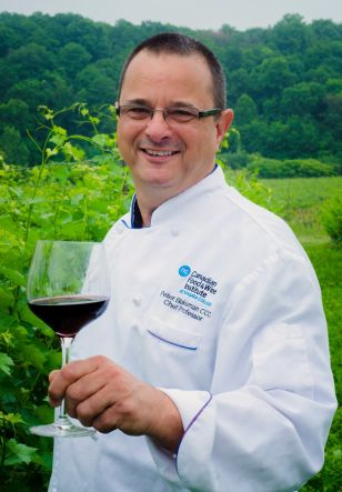 Peter Blakeman is pictured in the vineyards at the Niagara College Teaching Winery.
